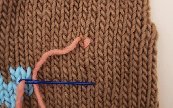 Sticke Muster auf Gestricktes